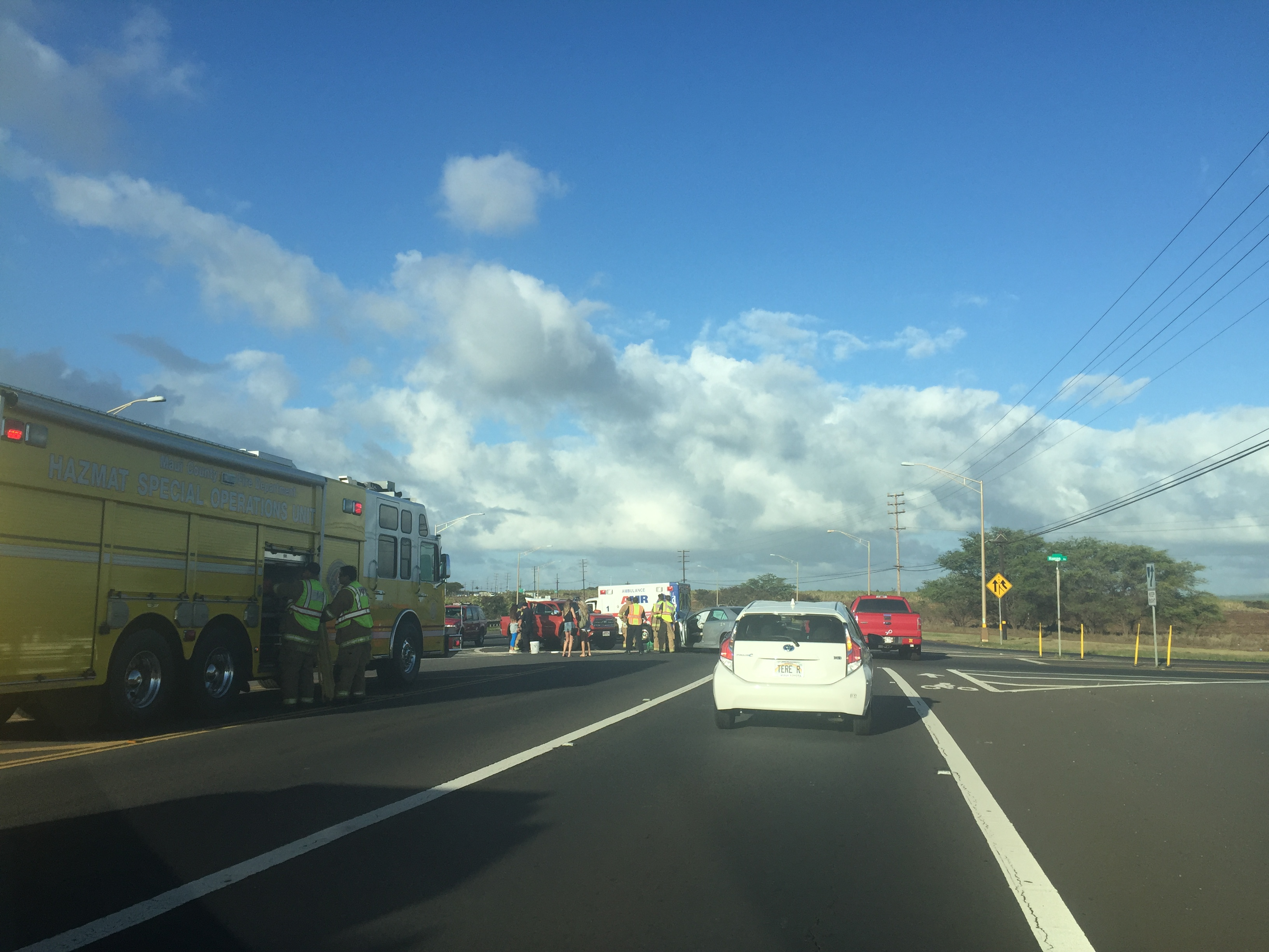 Emergency crews are on the scene of a motor vehicle accident on the Hāna Highway near the Hansen Road intersection. PC: Tara Dugan.