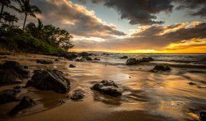 Sunset at Mokapu Beach. Photo Image: Chris Archer