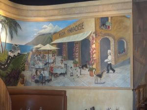 Mural on the wall at Pita Paradise. Photo by Kiaora Bohlool.