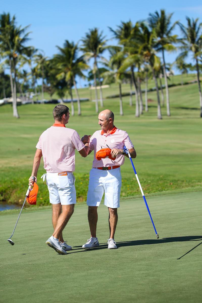 Doc Redman of Clemson is congratulated on the individual title by his coach during the final round of the 3rd annual Kaanapali Classic collegiate invitational. Kaanapali Royal Course Lahaina, Hawaii November 5th, 2016/ Photo by Aric Becker