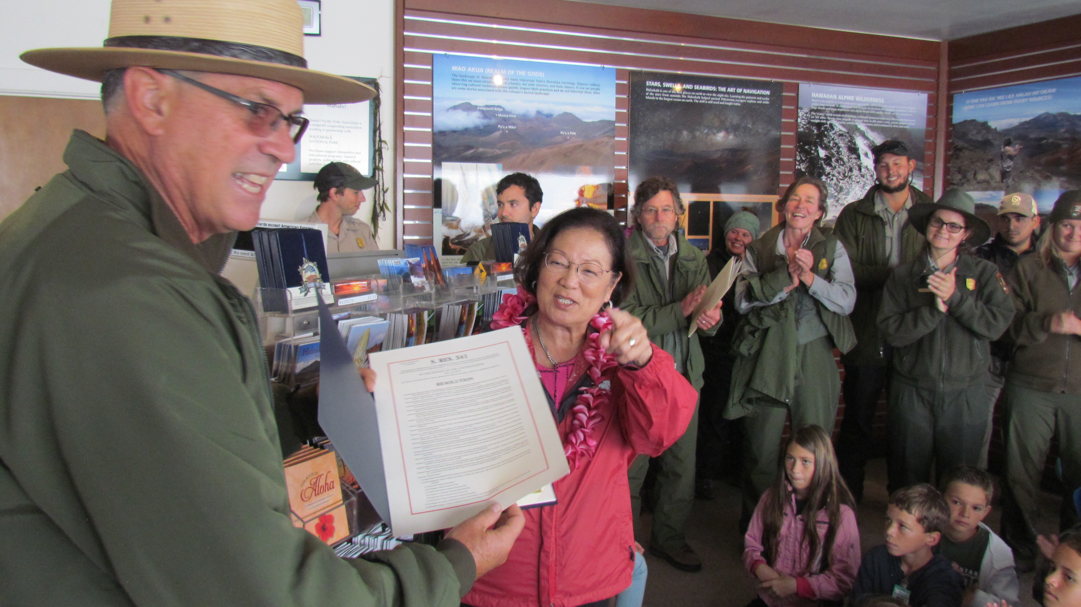 Hirono presents park staff with centennial resolution.