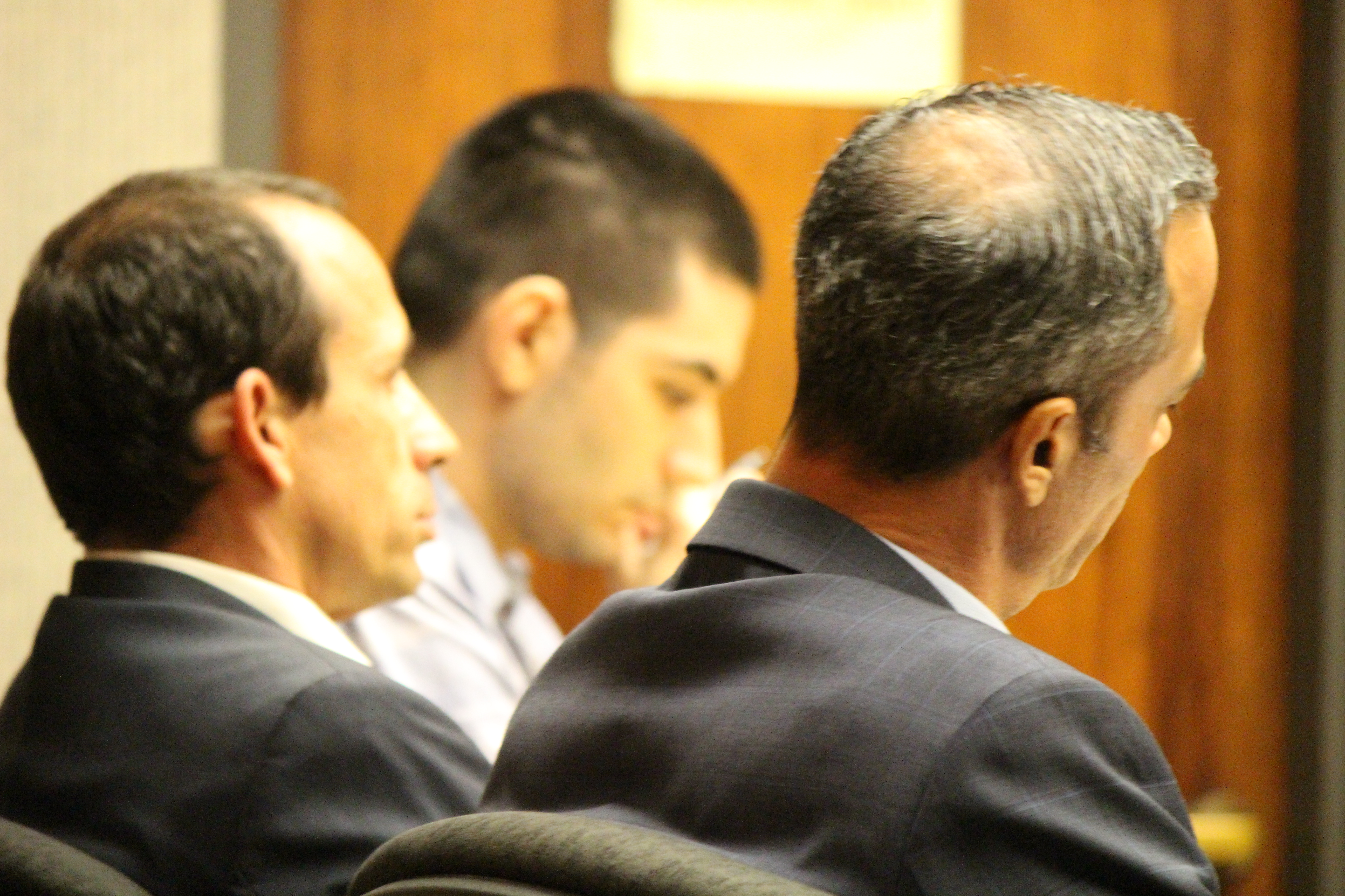 State v Capobianco trail. Defense Attorney Jon Apo in foreground (right) with fellow defense attorney Matthew Nardi (left) and defendant Steven Capobianco (background middle) . PC: 11.30.16 by Wendy Osher.