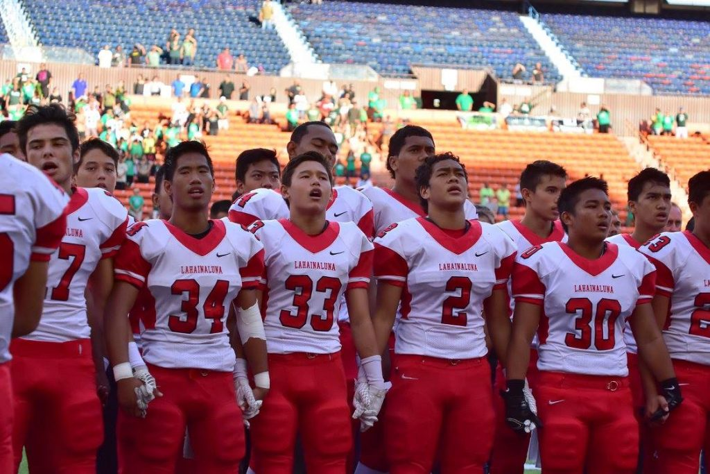 Lahainaluna sings its alma mater six times when playing on the road. Here they sing before the start of the D-II state championship game. Photo by Glen Pascual.