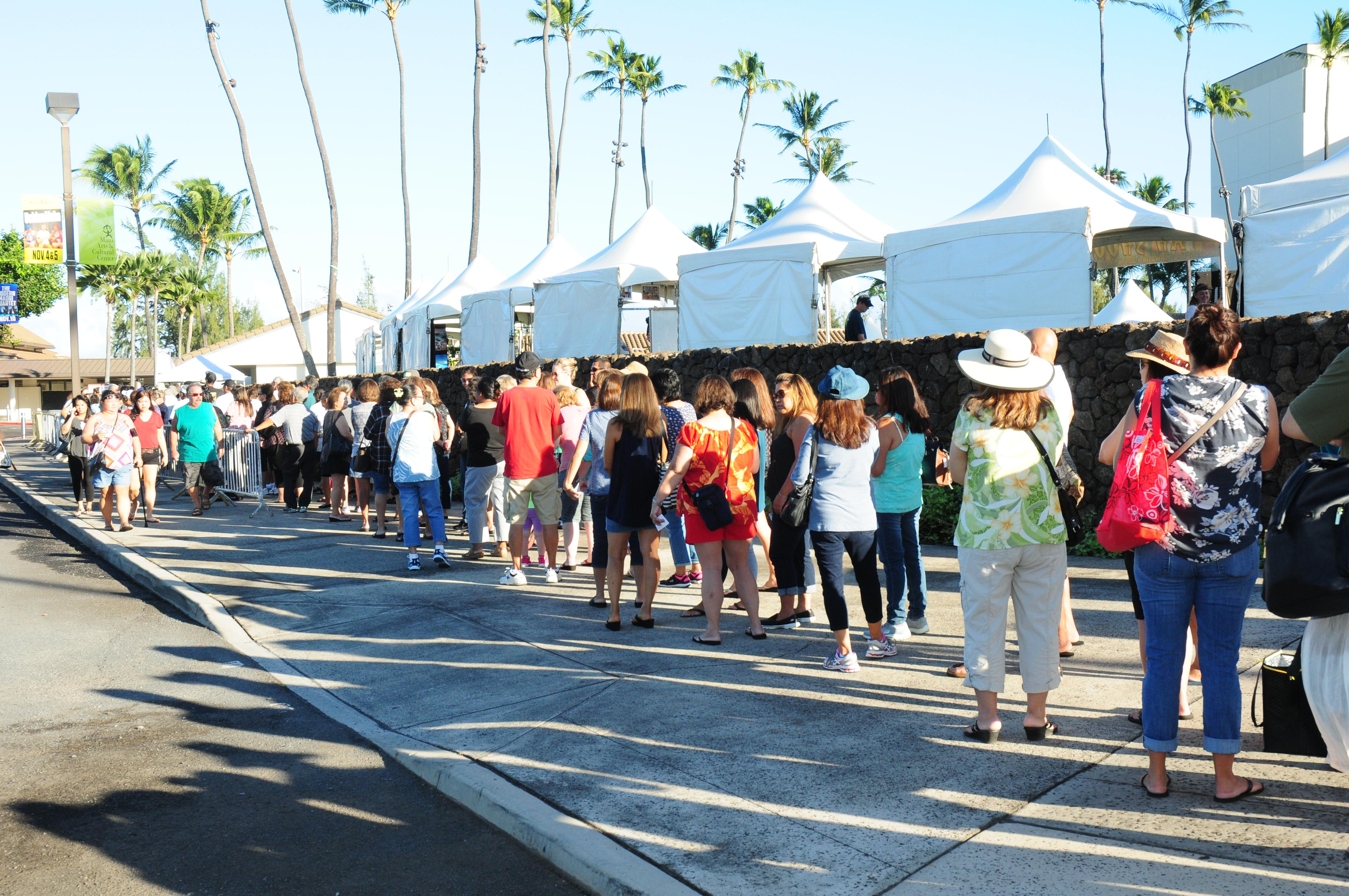 Before gates opened on Saturday, a long lined formed around the Maui Arts & Cultural Center. The first 2,000 people received a free Festival tote. Photo by Casey Nishikawa
