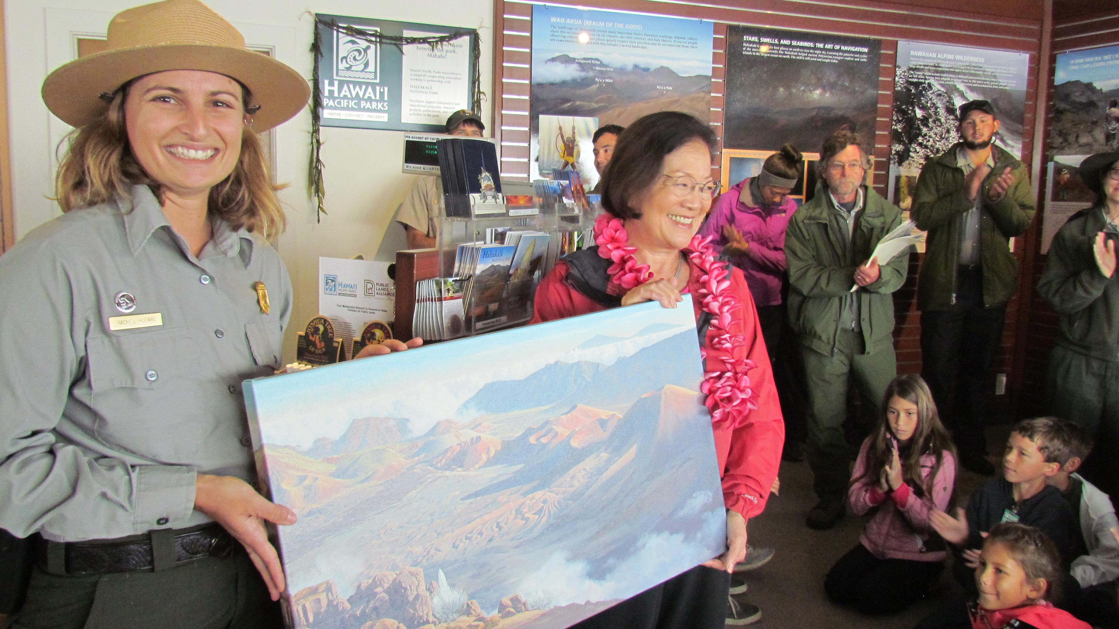 Staff present Hirono with painting.