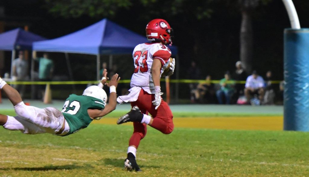 Lahainaluna's Joshua Tihada escapes Konawaena's last would-be tackler en route to a 43-yard touchdown run in the fourth quarter. Photo by Glen Pascual.