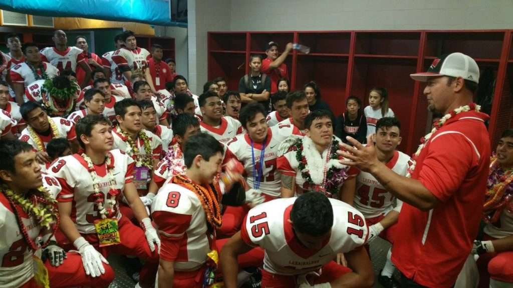 Lahainaluna coach Kenui Watson talks to the team in the locker room at Aloha Stadium following its Division II state championship victory over Kapaa. Photo by Glen Pascual.