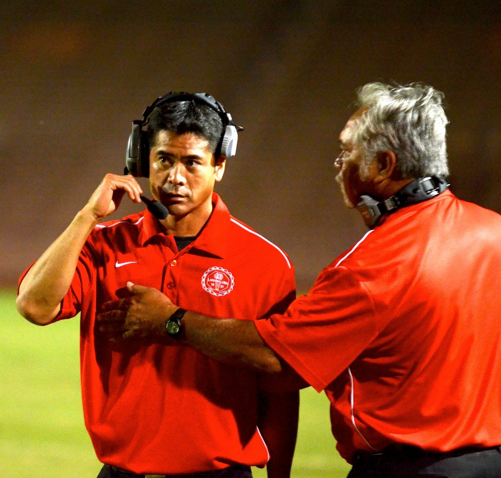 Co-head coaches Garret Tihada and Bobby Watson on the sidelines during an MIL game. File photo by Rodney S. Yap.