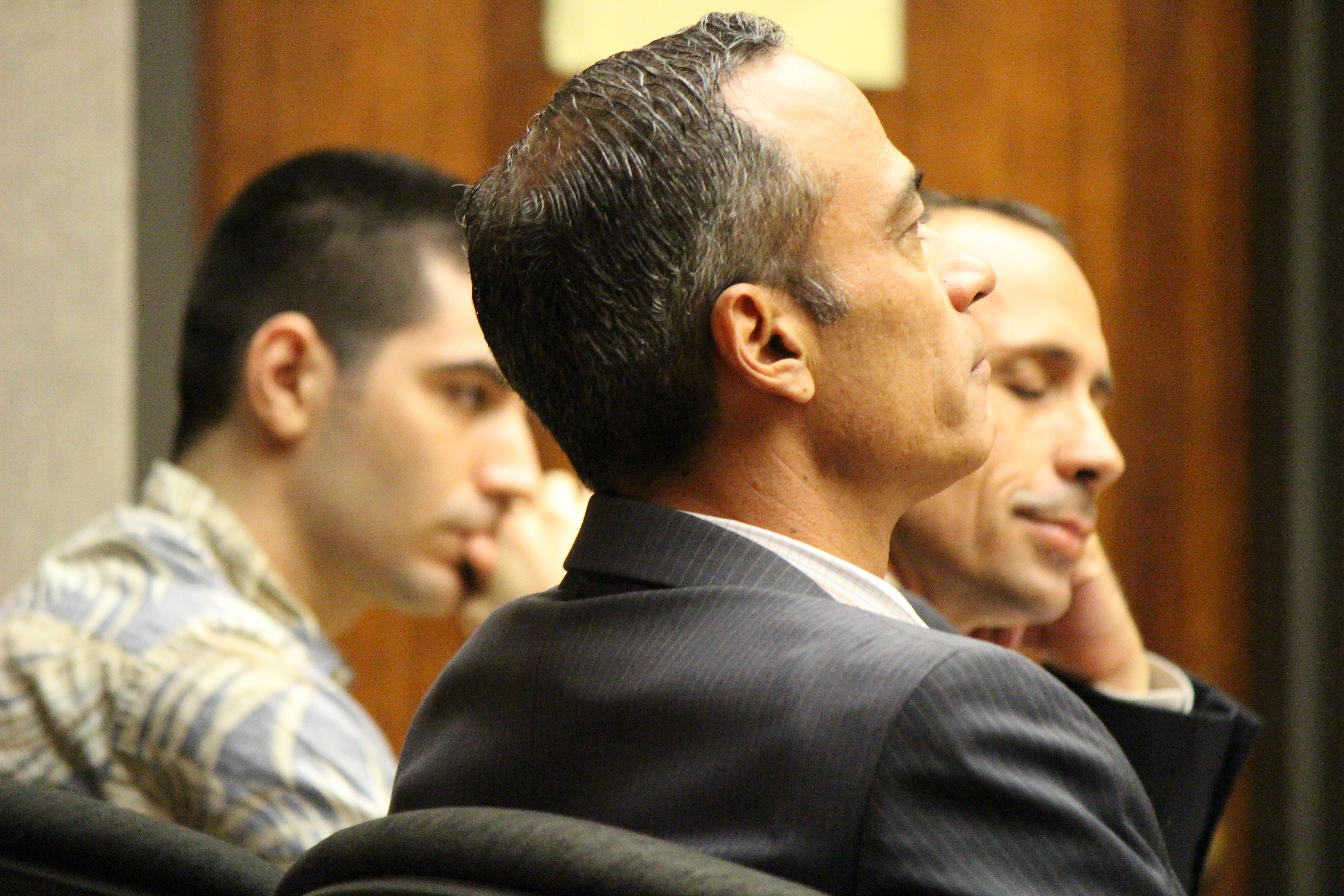 State v Capobianco trail. Defense Attorney Jon Apo in foreground (right) with fellow defense attorney Matthew Nardi (left) and defendant Steven Capobianco (background middle) . PC: 12.01.16 by Wendy Osher.