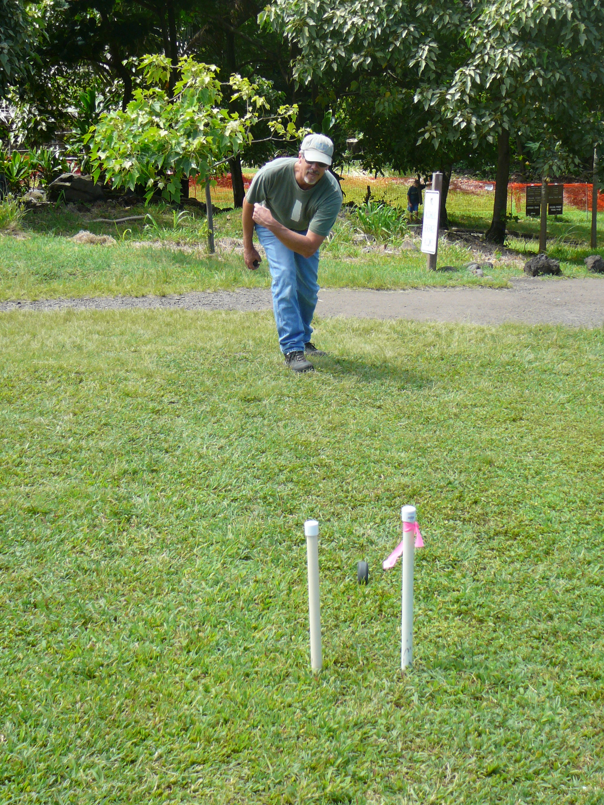 A visitor plays ulumaika (lawn bowling) at Kīpahulu. PC: Haleakalā National Park