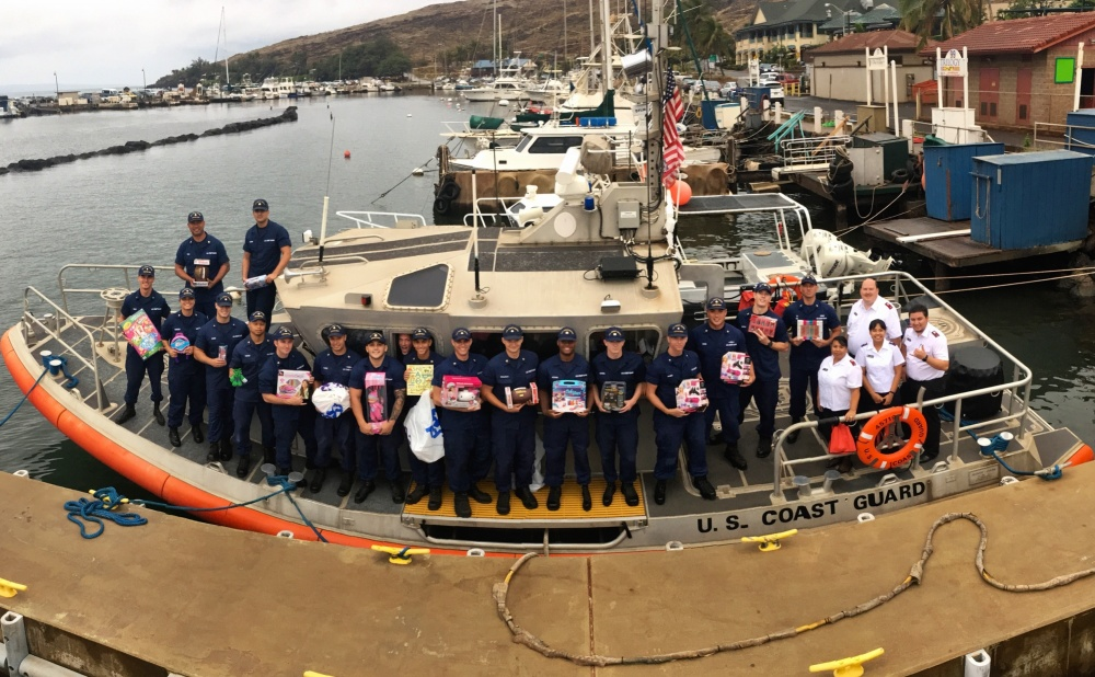 Members of Coast Guard Station Maui team up with the Salvation Army to deliver 800 toys and clothes to the children of Molokai Dec. 9, 2016. The Coast Guard has been assisting in community needs around the nation for more than 200 years. (U.S. Coast Guard photo by Petty Officer 2nd Class Rob Lester/Released)