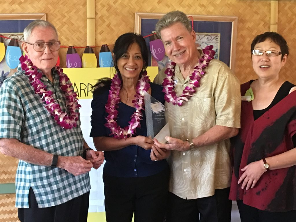 AARP Hawaii State Volunteer President Gerry Silva (left) presents the Andrus Award for community service in Hawaii to Lena and Bill Staton. AARP Hawaii State Director Barbara Kim Stanton looks on.