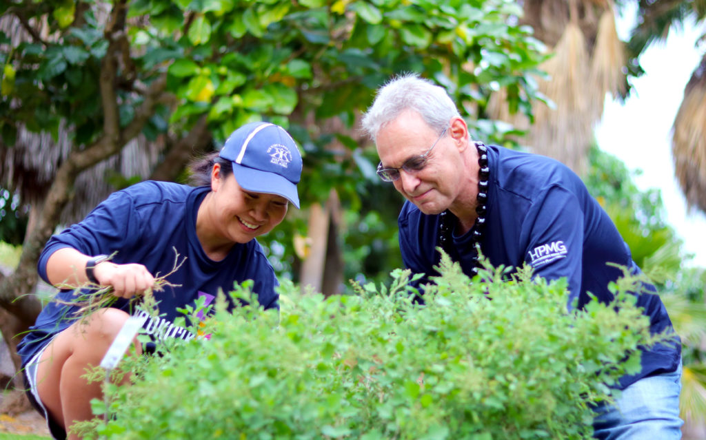 Dr. Lisa Sodetani And Dr. David Ulin (Associate Medical Director, Maui)  Remove Weeds From A Planting Area At The Maui Botanical Garden.