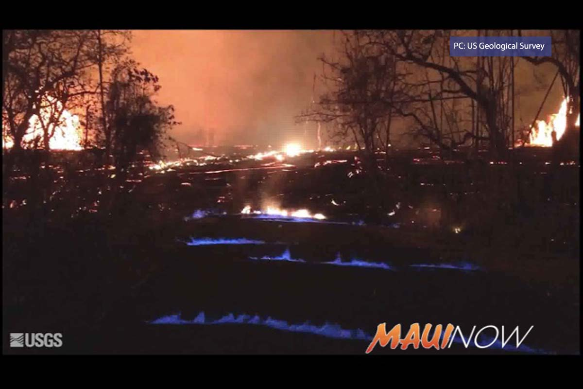 Methane Rises From Volcano Cracks Creating Blue Flames
