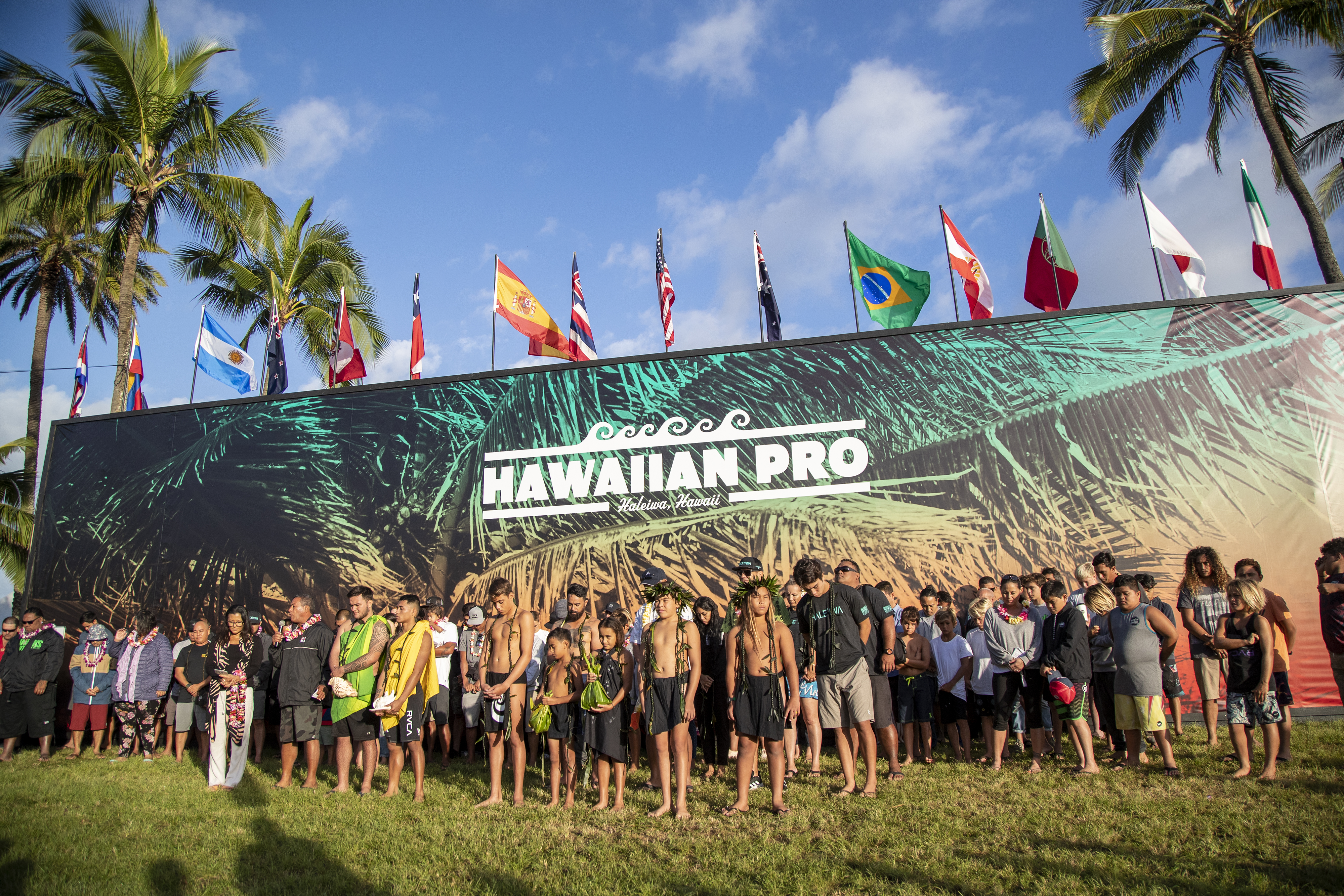 345dfaeffb Surfers gather for the pule or blessing during the opening ceremony of the  Hawaiian Pro at Haleiwa