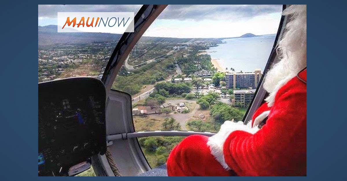 Santa Trades in Sleigh for a Helicopter Arrival via Blue Hawaiian