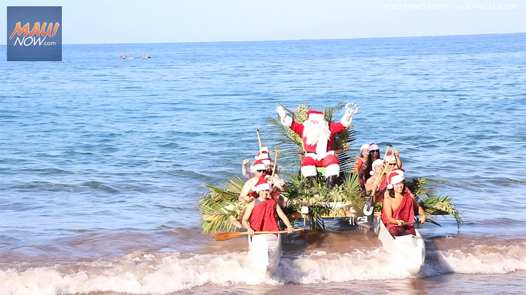 Santa Surfs into the Grand Wailea in a Hawaiian Outrigger Canoe