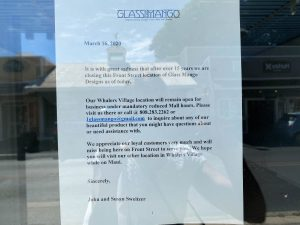 Sign on door that Glass Mango Designs has closed for good on Front Street.