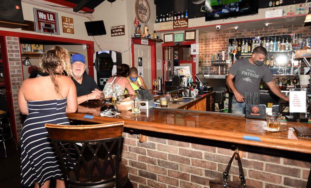 Customers enjoy a drink inside Da Babooze Bar in Wailuku.