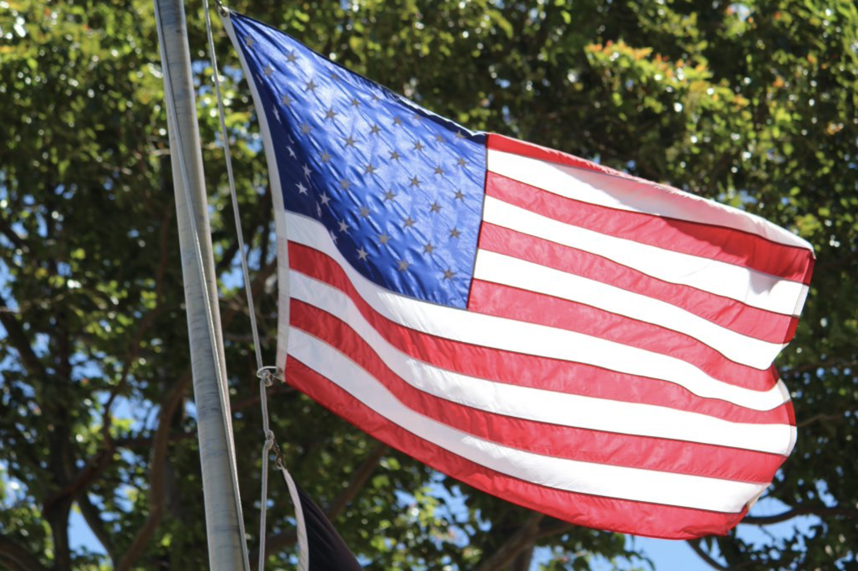 Flags Lowered to Honor Victims in Colorado Shooting