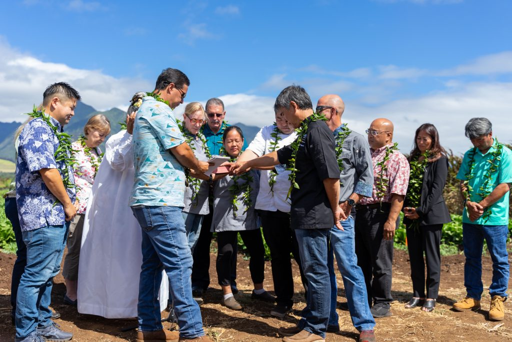 Chefs and executives surrounded a bible as three prayers were recited in Hawaiian Thursday morning. Photo by JD Pells.